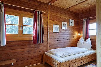 Schlafzimmer im Ferienhaus auf dem Reiterhof Schanzer in BAyern